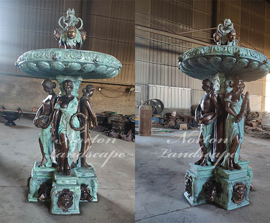 Bronze woman statues fountain