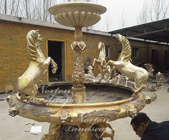 Bronze fountain with horse statues