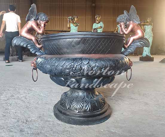 bronze flowerpot with angel statues