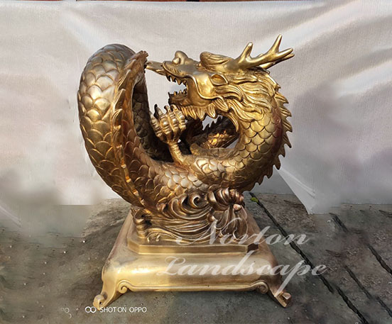 brass dragon sculpture