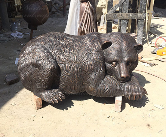 Bronze sculpture of bear catching fish