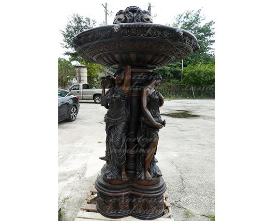 Bronze woman statue fountain