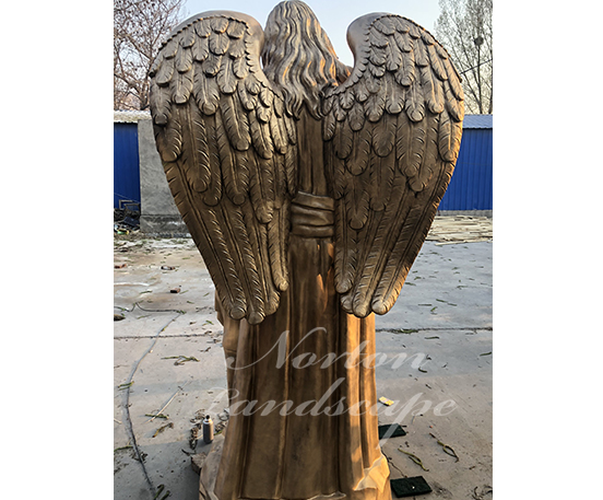 Brass angel and children statues