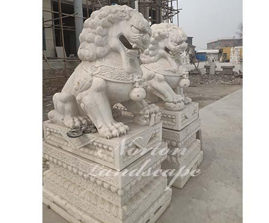 Large marble foo dog statues