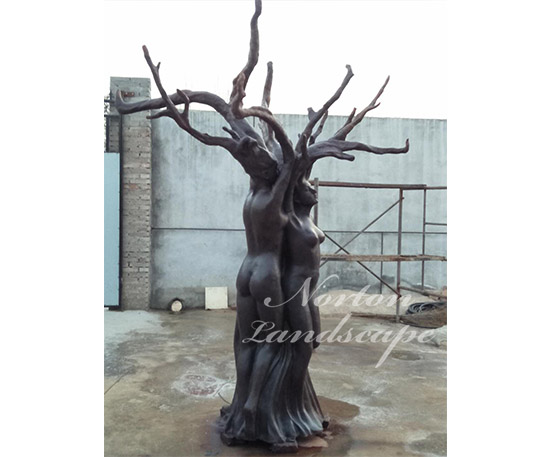 Bronze tree woman statue