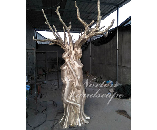 Bronze tree woman statue