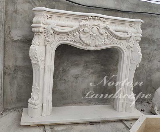 Hand carved European Style fireplace