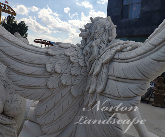 White marble angel statues with wings