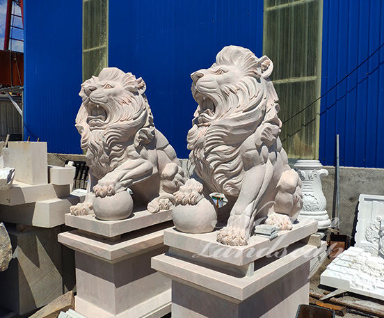 Sitting marble lion statues