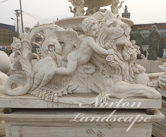 Marble cherub and lion statues