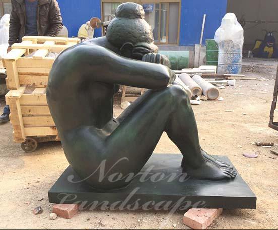 Bronze sitting nude woman statue