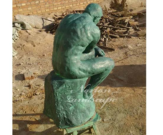 Bronze thinking man statue