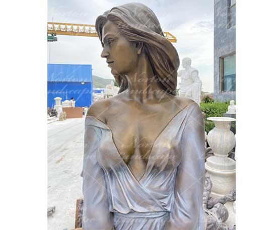Beautiful bronze woman statue