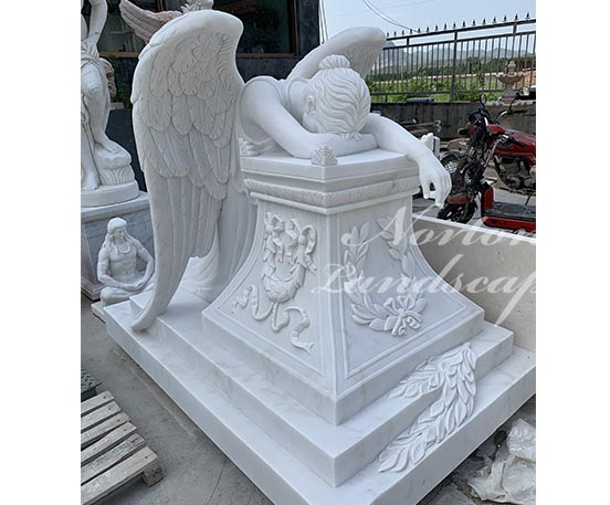 Large white marble angel statue tombstone