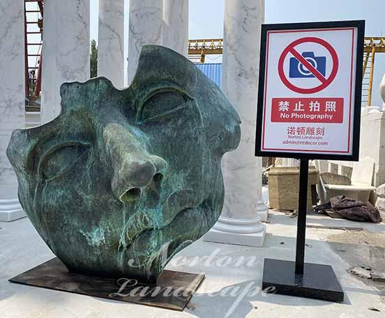 Bronze face statue