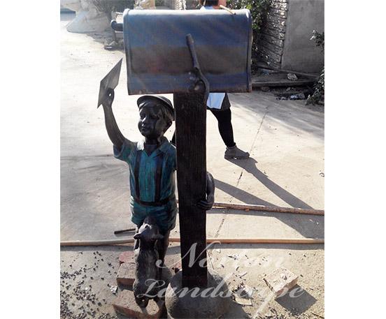 Bronze statue of little boy playing golf