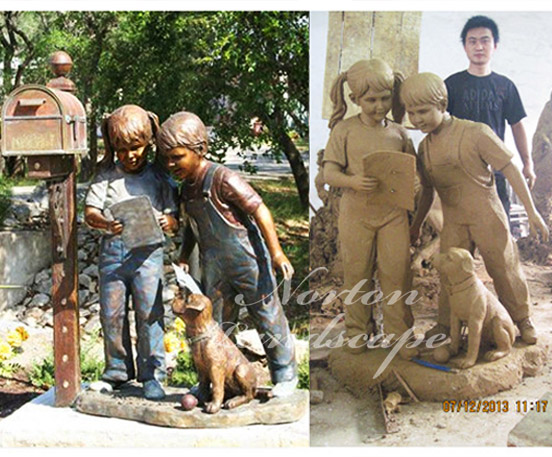 Bronze boy and dog statues