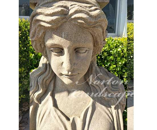 Antique woman statue pillar