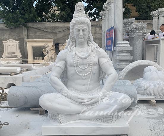 White marble sitting shiva statues fountain