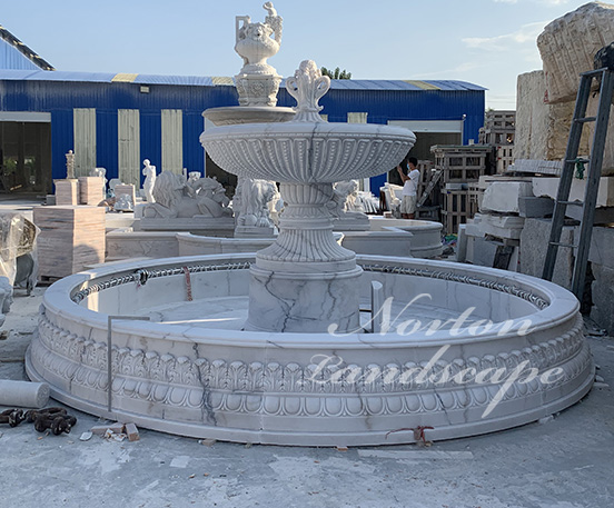 Large white stone marble water fountain