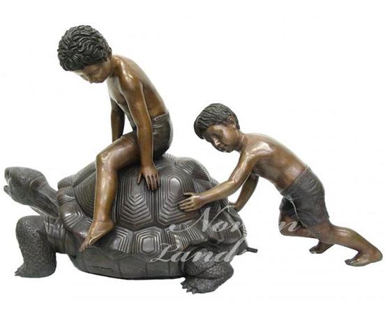 Bronze tortoise and child statue