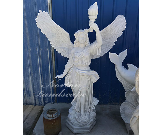 Marble statue of an angel holding a torch
