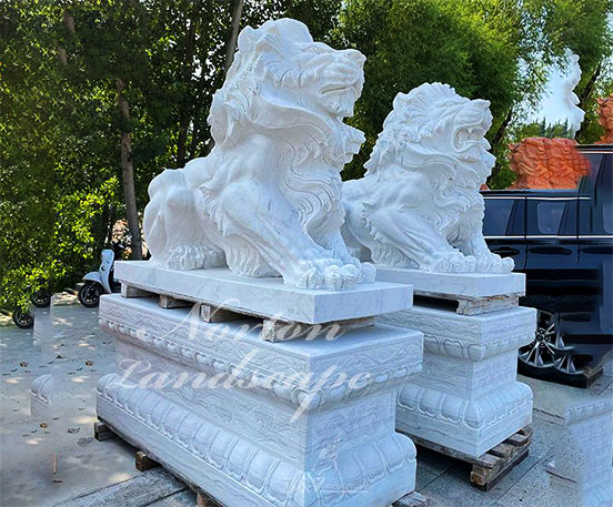 A pair of front door lion statues